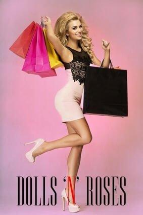 Smiling happy blonde fashionable woman shopping. Studio shot.